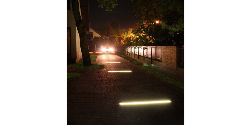 Linear backlight for entry from paving stones